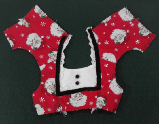 11 sew bib to front of bodice by sewing to facing